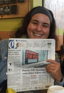 Anna with front page toilet news she helped make.
