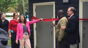 A neighbor who remembers using colored-only park toilets cut the ribbon.